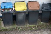 Four Garbage Bins Colour Coded For Recycling