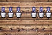 picture of edelweiss  - Row of cowbells with Edelweiss decoration on a wooden board - JPG