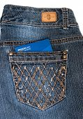 DAYTON, OHIO - FEBRUARY 2, 2014: Bandolino jeans pocket with Amazon credit card. Bandolino is fashions by designer, Enzo Anioglini; Amazon is the worlds largest online retailer operating since 1995.
