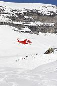 picture of rescue helicopter  - Rescue helicopter lands in a skiing region - JPG
