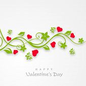 Happy Valentines Day celebration concept with beautiful floral design and pink heart shapes on grey