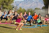 picture of boot camp  - Serious boot camp exercise class squatting with weights  - JPG