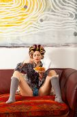 stock photo of knickers  - sexy girl eating spaghetti on the couch - JPG