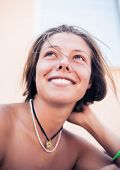 Beautiful young smiling woman with bare shoulders
