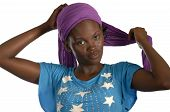 Young African Woman Putting Her Bandana On