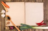 Cookery book on wooden background