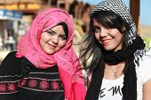 DAHAB, EGYPT - JANUARY 30, 2011: Portrait of modern young Egyptian girls woman wearing hijab, tradit