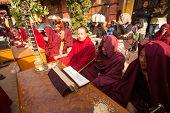 KHATMANDU, NEPAL - DEC 17, 2013: Unidentified tibetan Buddhist monks near stupa Boudhanath during festive Puja of H.H. Drubwang Padma Norbu Rinpoche's reincarnation's.