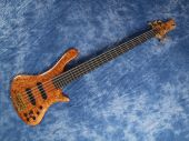 Curved Patterned Wood Bass Guitar On Blue