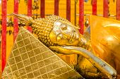 stock photo of recliner  - Reclining Buddha at Wat Phra That Doi Suthep - JPG