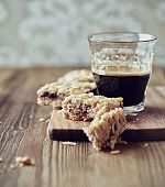 Homemade almond flapjack and a glass of espresso