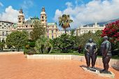MONTE CARLO, MONACO - JULY 13, 2013: Adam and Eve sculpture by Fernando Botero in gardens near Salle