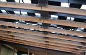 foto of purlin  - Detail of metal roof with wood rafter - JPG