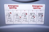 picture of aeroplan  - View of Emergency instruction sign inside of aeroplane - JPG