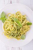spaghetti and pesto sauce