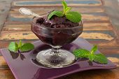 Acai Pulp In Glass With Fresh Mint On Purple Plate