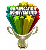Gamification Achievement words and stars shooting out of a golden trophy as a prize or reward for ad