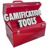 Gamification Tools words in 3d letters in a red metal toolbox as skills, knowledge or resources to h