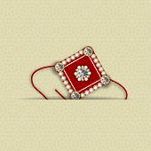 foto of rakhi  - Beautiful maroon rakhi decorated with diamonds on brown background for Hindu community festival Raksha Bandhan celebrations - JPG