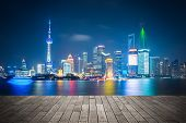 Shanghai Skyline At Night  With Wooden Floor