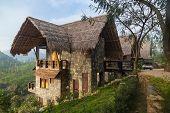 ELLA, SRI LANKA - MARCH 3, 2014: Small bungalow resort with stunning view on on famous tea plantatio
