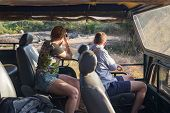 YALA NATIONAL PARK, SRI LANKA - MARCH 4, 2014: Tourists taking photos from jeep during safari tour in the Yala park. Yala is the second largest national park in Sri Lanka.