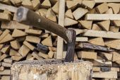 pic of firewood  - Some firewood and an axe for making new firewood - JPG
