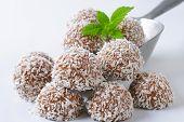 detail of chocolate coconut pralines on metal scoop