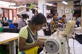 COLOMBO, SRI LANKA - MARCH 12, 2014: Local women working on sewing machine in apparel industry. The
