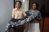 COLOMBO, SRI LANKA - MARCH 12, 2014: Local women in batik workshop. The manufacture and export of te