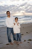 African-American father and son on beach