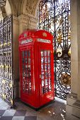 LONDON, UK - JUNE 24, 2014: Phone box in Westminster, red symbol of Great Britain