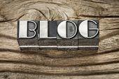 blog word in letterpress metal type printing blocks against weathered grained wood
