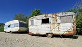 stock photo of caravan  - Two old decayed and abandoned caravan in nature - JPG