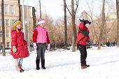 picture of snowball-fight  - Children in Winter Park playing snowballs - JPG