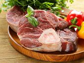 image of beef shank  - fresh raw meat ossobuco on a wooden board - JPG