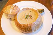 stock photo of clam  - Close up of a Sourdough Clam Chowder gourmet dish - JPG