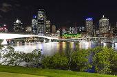 Brisbane cityscape and Victoria bridge by night over the Brisbane river