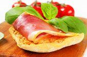 Slice of prosciutto crudo on crispy bread