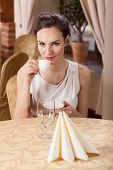 Woman Drinking Espresso In A Restaurant
