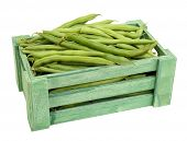 French beans in wooden box isolated on white