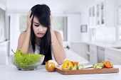Woman Hesitate To Eat Salad