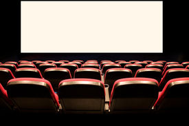 stock photo of movie theater  - Backs of empty red seats in a movie theatre with a white screen - JPG