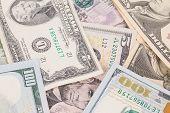 Close up of different dollar bills