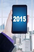 Manager Hands Holding Smartphone With Number 2015