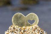 Heart In Sand Hill On A Rocky Beach