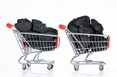 shopping carts with coal stones isolated on white