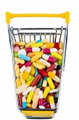 colorful tablets in the shopping cart icon photo for health care costs, pharmacies, abundance of drugs