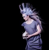 Fashion Hairstyle With Feathers
