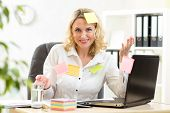 image of overwhelming  - funny businesswoman overwhelmed with sticky reminder notes - JPG